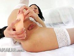 Unbelievably long dildo in her bum