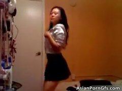 Slender asian brunette hoe gets naked