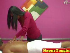Asian masseuse tugging client cock