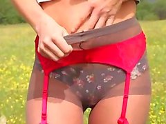 extreme striptease outdoor by the forest