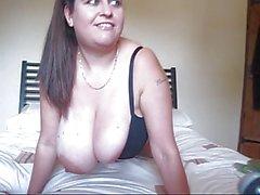 bursting out of black bra