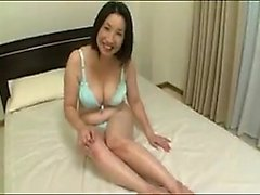 Big breasted Oriental lady has two boys fulfilling her sexu
