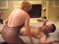 Mature blonde wearing her fishnet suit rides cock like a cowgirl