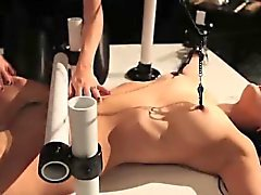Dominated lesbian clamped and whipped