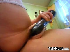 Horny Girl Playing With A Black Dildo