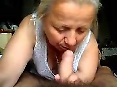 Kinky mature lady drops to her knees and gives a nice blowj