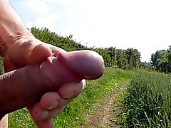 Naked outside public field playing with cock & cumming #2