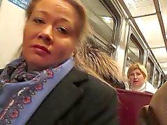 girl flashing fishnet stockings in a train