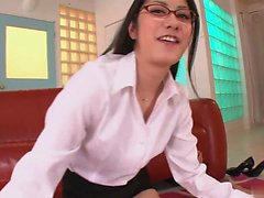 Nerdy looking babe jerks two cocks using both her hands