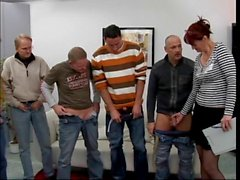 Mature red head whore gets naked in front of five guys