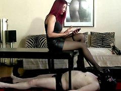 Mistress in sexy high heels, pantyhose and slave
