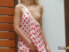 young blonde in dress masturbating