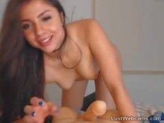 Cute brunette sucks dildo on webcam