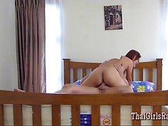 Little Thai girl works a white cock
