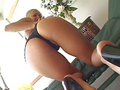 Slutty blond whore face and ass fucked by black cock on the patio