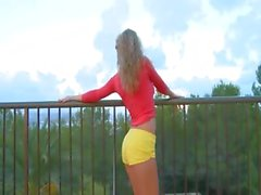 Russian blonde dildoing on the terrace