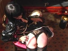 Latex Mistress playing with her blonde slaves