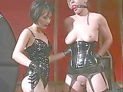 Lesbian babe in leather spanks and gags slut