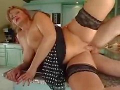 Busty mature enjoys a much younger cock in all holes