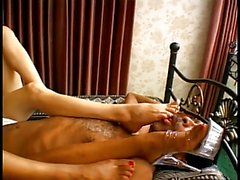 Two hot chicks enjoy licking each other's toes in the bedroom