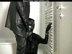 Latex bdsm bondage slave sucking cock