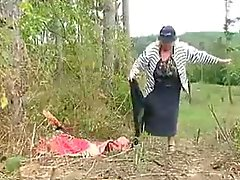 Big Tit Granny Fucks in the Woods