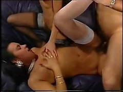 Retro sluts and their men in a classic orgy porn movie