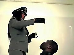 Uniform mistress cumdrenching her black slave