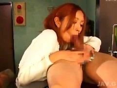 This brunette slut gives a wet blowjob to a big cock