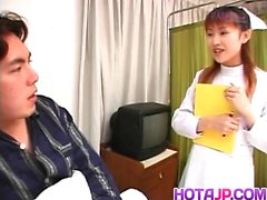 Rina Usui nurse is touched on cans while stroking patient