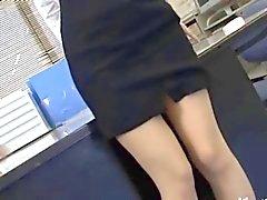 Азиатского секретарем Токио при заднице молоке