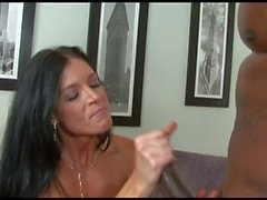 Stunning MILF takes a fit black hunk home to fuck