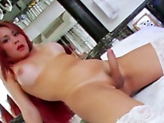 Red head tranny Viviancy plays her cock
