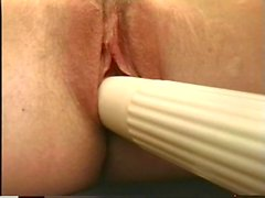 Mature sticks vibrator up her pussy in the office