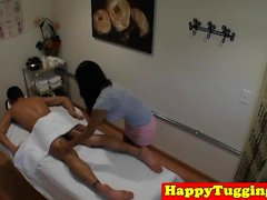 Bigtitted asian masseuse titfucks and tugs