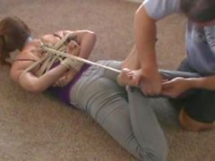 bondage girl hogtied butt crack jeans