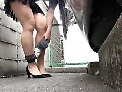 Asian urinates in carpark