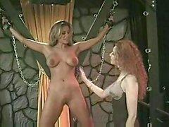 Busty lesbian in bondage tortured
