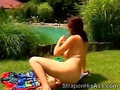 Busty redhead plays with her pussy outdoor in backyard