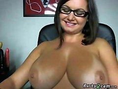 Hot milf puts a big dildo inside her