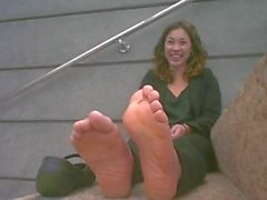 Cute girl shows her stinky feet