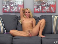 Sexy slender blonde Aaliyah Love brings herself to orgasm on the sofa