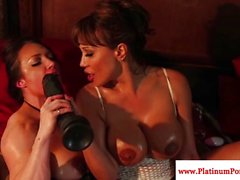 Ava Devine and Brandi Mae play with toys
