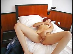 Redhead slut loves touching herself
