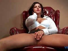 Hot brunette strips then masturbates in office chair
