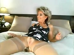 Sexy mature inserts a gadget up her butt on livecam