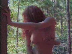 Redhead gurl fucks in wood