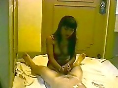 Thai Hooker Giving Her Customer A Handjob