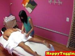 Asian masseuse jerking client on spycam