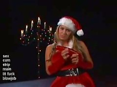 Busty MrsClaus plays with a plastic present